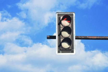 closeup of traffic light with blue sky