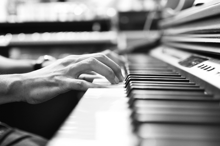 Close up of musician playing piano