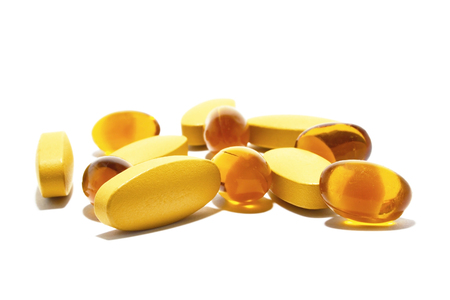 Vitamin and Fish oil on white background