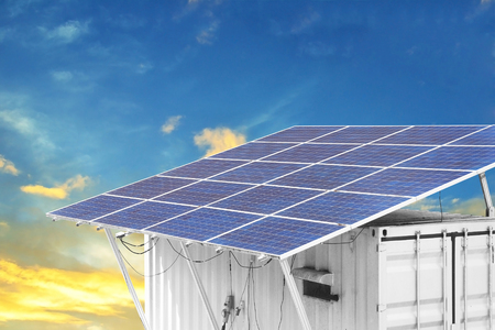 container box with solar panels on the roof Archivio Fotografico