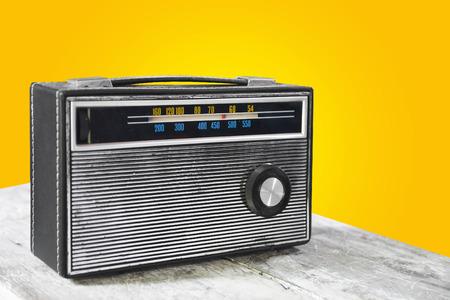 old retro transistor radio on wooden table