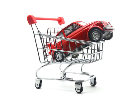 car in shopping cart on white background