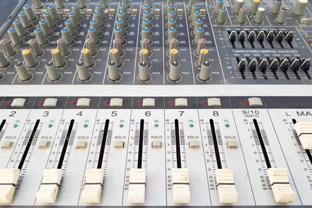 close up of sound mixer board
