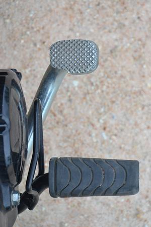 close up brake pedal of motorcycle