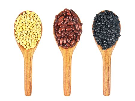 soy beans, red beans and black beans with wooden ladle isolated on white background