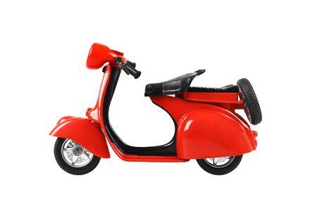 rotes Retro-Motorradspielzeug isoliert auf weißem Hintergrund