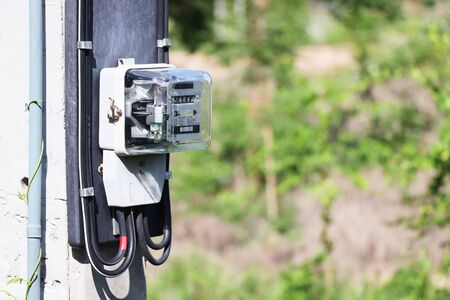 close up of electric meter on electric pole, electrical equipment