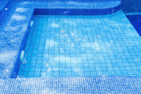 blue tile swimming pool water reflection Stock Photo