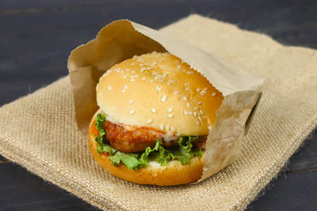 close up of burger on wooden table Stock Photo