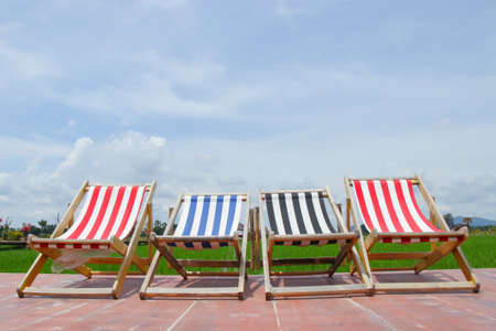 deck chairs with blue sky background