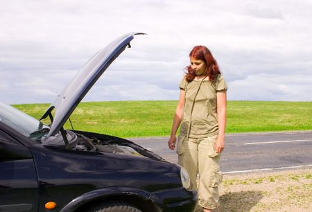 Woman and car on road photo