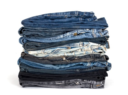 stack of various jeans isolated on white Stock Photo - 9090447
