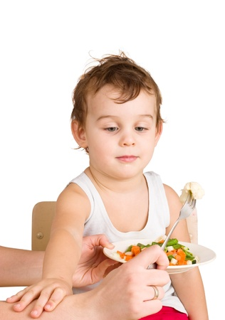 Kid does not want to eat salad photo