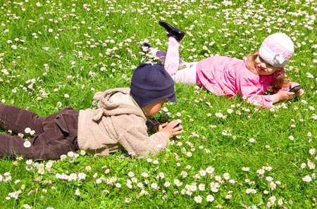 Boy and girl playing in the park photo