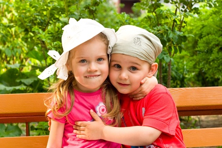 little boy and girl embrace in summer park Stock Photo - 9772992