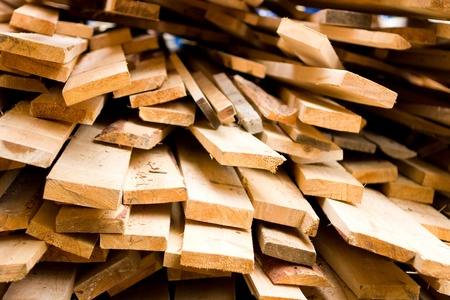 Planks of wood stacked photo