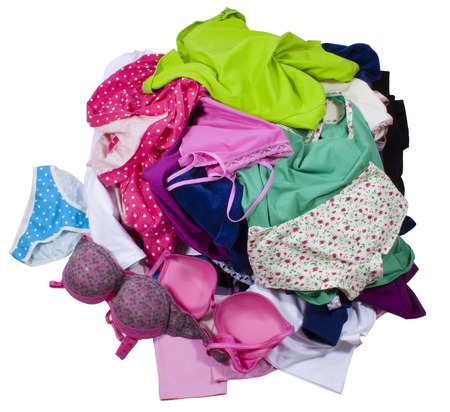 undies: Lots of messy colorful clothes isolated on white background. Clipping paths included.