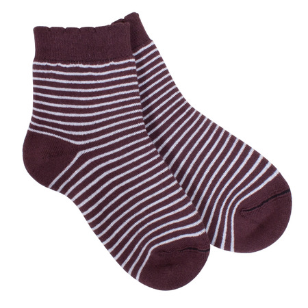 children s feet: Striped socks isolated on white background. Clipping paths included. Stock Photo