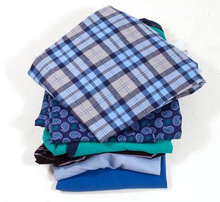 laundry pile: A family laundry pile on white background