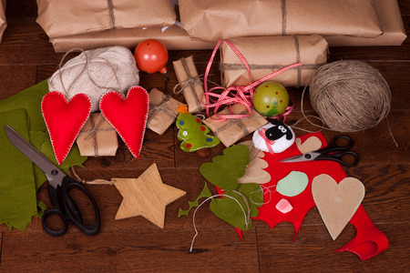 surprise gift: Christmas gift and decorations for tree on wooden background Stock Photo