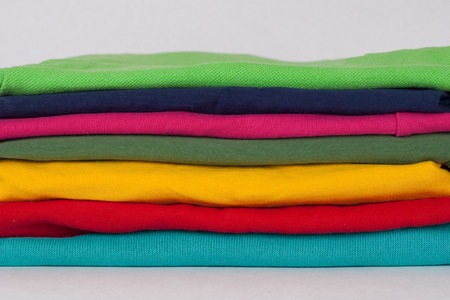 highboy: Background with stack of various colorful sweaters