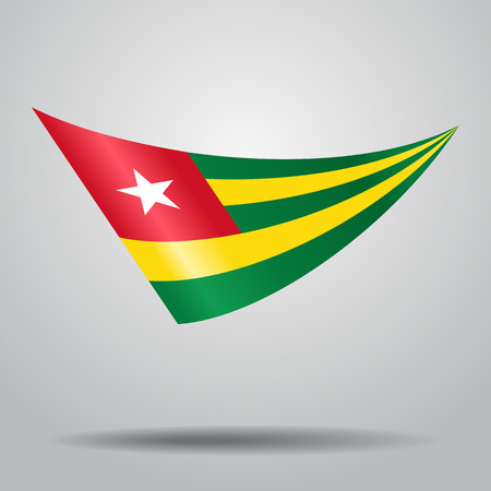 Togolese flag wavy abstract background. Vector illustration.