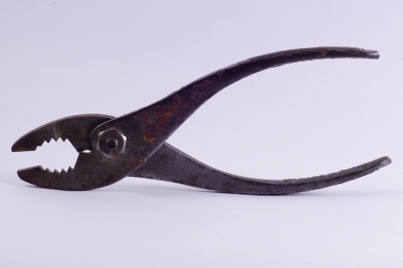old iron pliers on white background photo