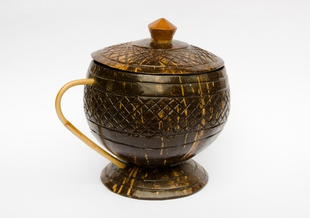Tea cup or coffee cup made of coconut shell and cover photo