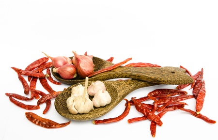 dried chilli, onion and garlic in ladle on white background Stock Photo