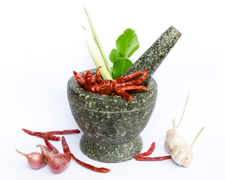 thai foodstuffs in mortar inclute chilli, garlic, onion,lamon grass  and spices photo