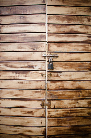 Locked wooden door photo