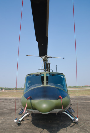 landing strip: helicopter standing on landing strip in airfield