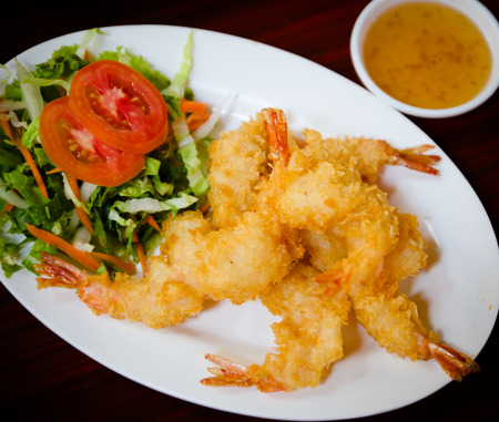 Breaded Butterfly Prawns - Deep fried battered prawns filled with garlic sauce photo