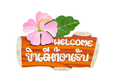 Welcome sign that imitate wood and flowers  photo