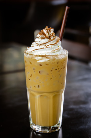 Iced coffee with whipped cream on the table