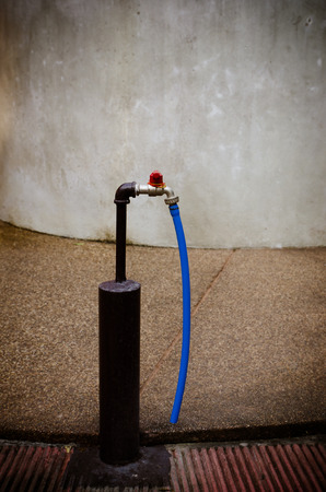Faucet with blue rubber wire photo