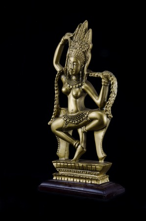 apsara: Apsara sculpture on dark background