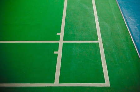 green floor badminton court Stock Photo