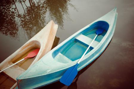 Kayaks in lake, Colorful plastic boat photo