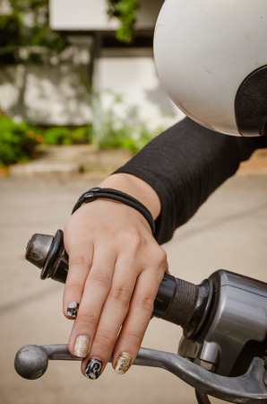 Womans hand grip motorcycles. photo