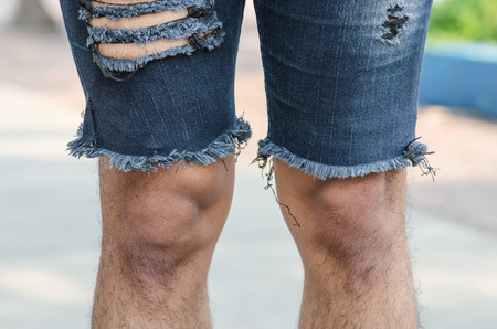 fetishes: the closeup of torn jeans Stock Photo