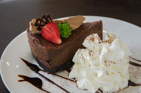dark chocolate: Delicious Piece of Chocolate cheesecake with strawberry