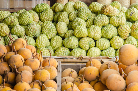 prickly fruit: custard apples sales in the fruit market .