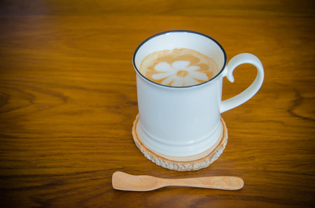 cappuccino cup: Cup of cappuccino coffee on wooden table background