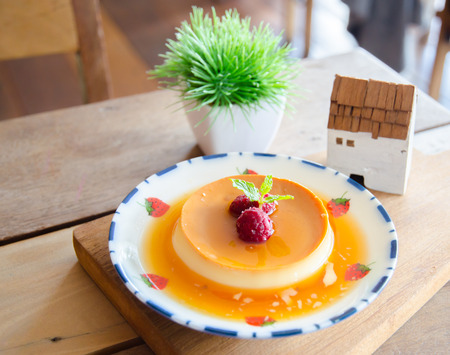 caked: caramel custard dessert and red berry with honey on dish