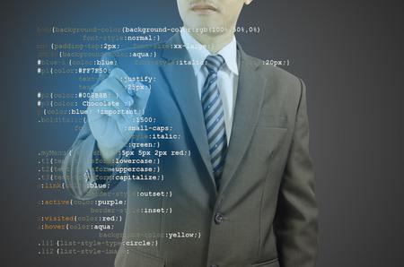 programmer computer: website development - programmer writing CSS code Stock Photo
