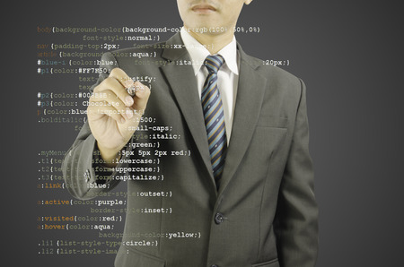 website development - programmer writing CSS code Stock Photo