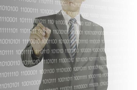 digital code: businessman pointing pen at the digital code