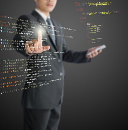 java script: website development - programmer writing HTML, CSS and Java Script code Stock Photo