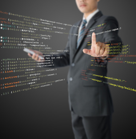 css: website development - programmer writing HTML, CSS and Java Script code Stock Photo